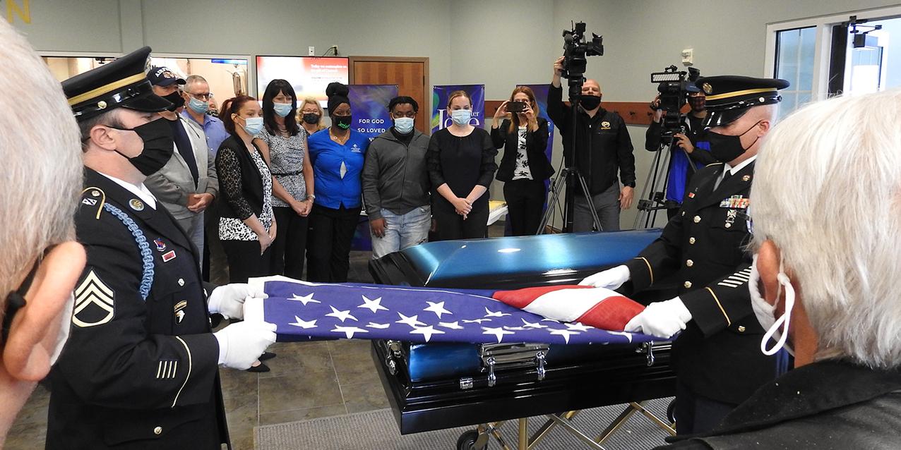 Faith family, funeral home, community rally, arrange veteran's funeral
